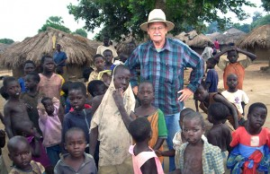 Ken Goyer with kids in village